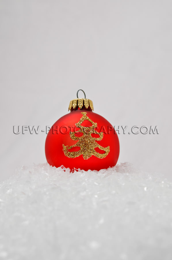 Red Christmas Tree Ball, golden ornament, laying in the snow - S