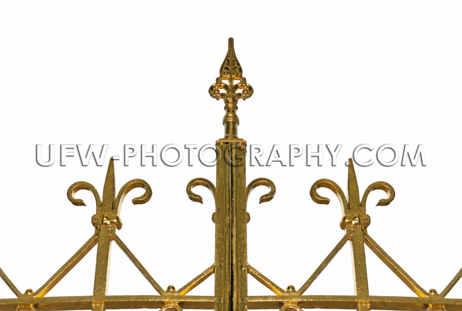 Top of golden ornamental iron gate Stock Image