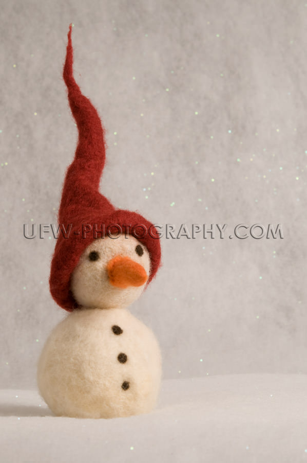 Toy snowman with spiked red hat, carrot nose, coal buttons - Sto