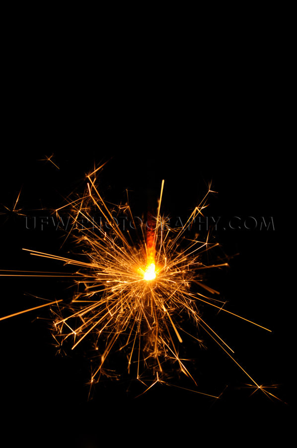 Sparkling sparkler glowing red black background copy space Stock