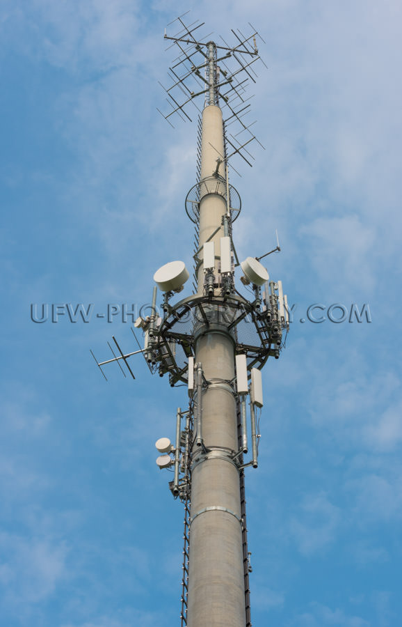 Communication antenna concrete tower mobile phone network Stock
