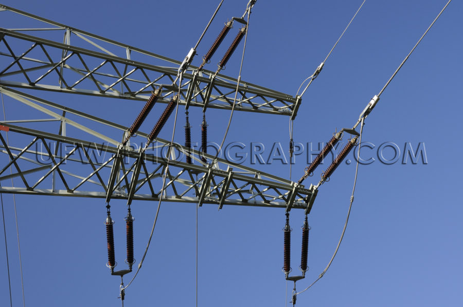 Electricity pylon arm insulator power line deep blue sky Stock I