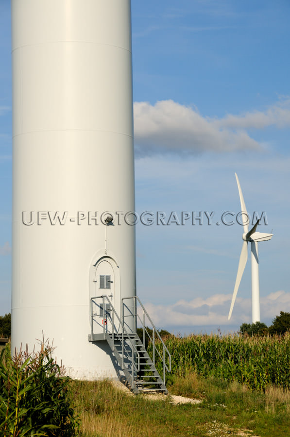 Huge tower base wind turbine staircase door countryside Stock Im