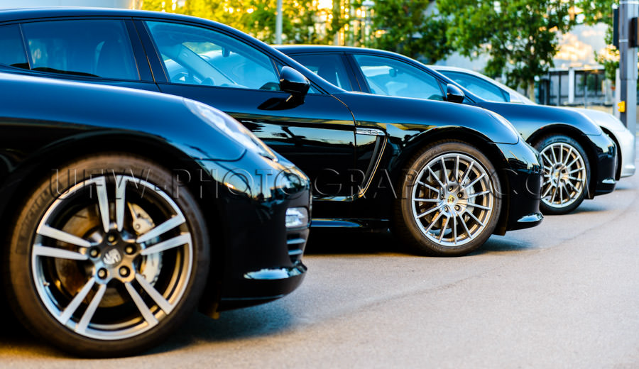 Porsche Panamera row black sports wheel front side view Stock Im