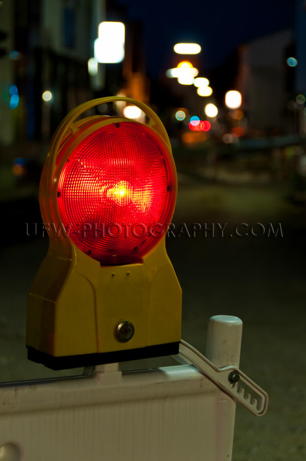 Red warning light at a road construction site, night shot - Stoc