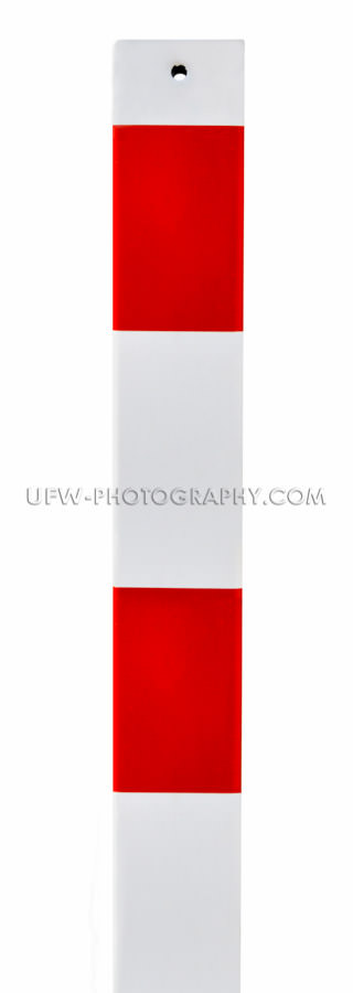 Traffic warning sign Red and white metal barrier post, isolated