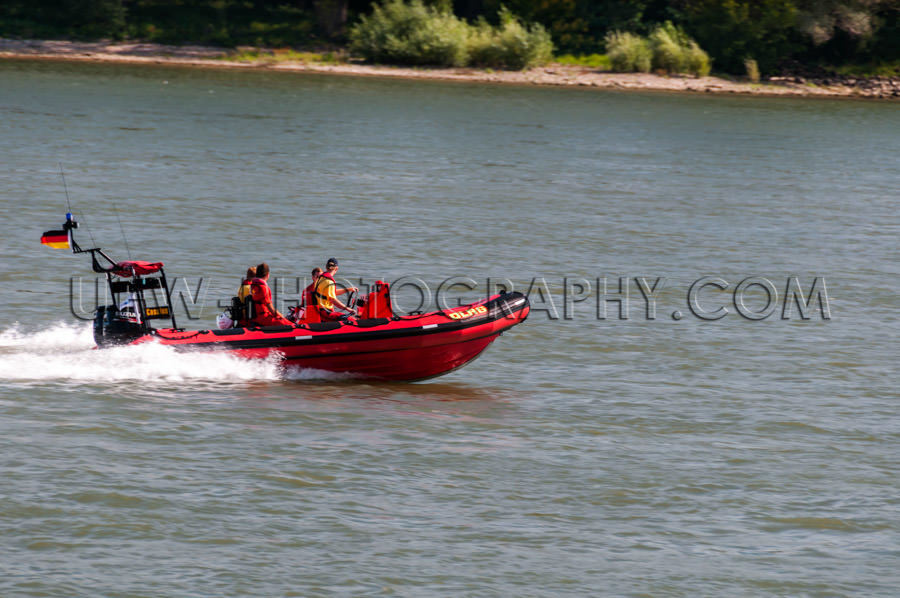 Water rescue motorboat red speeding river people Stock Image
