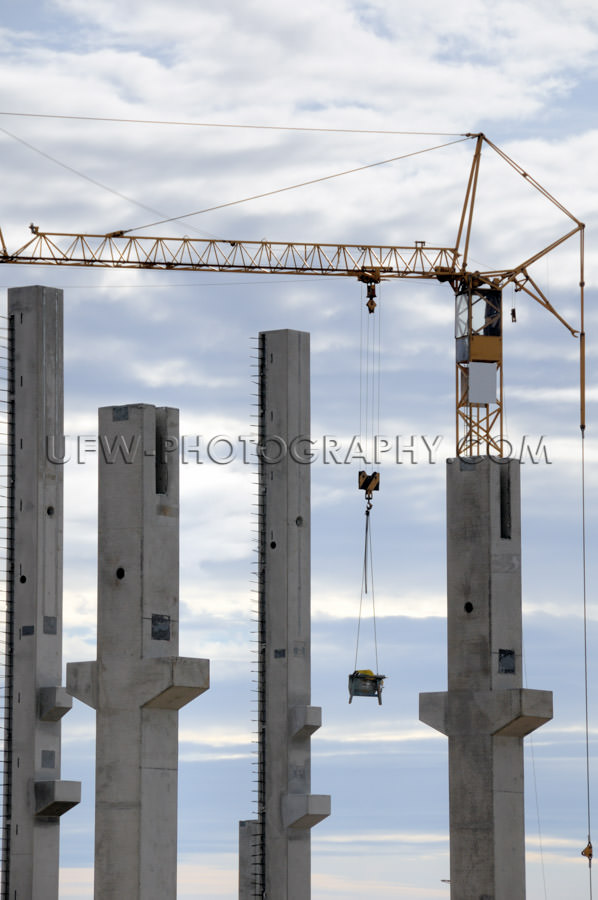 Construction site prefabricated concrete pillars tower crane Sto