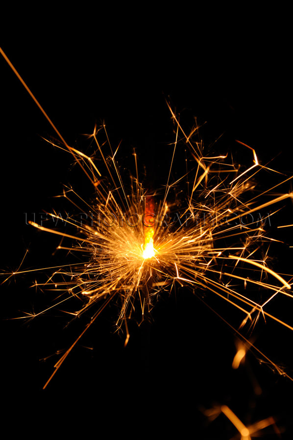 Flying red hot sparks glowing sparkler black copy space Stock Im
