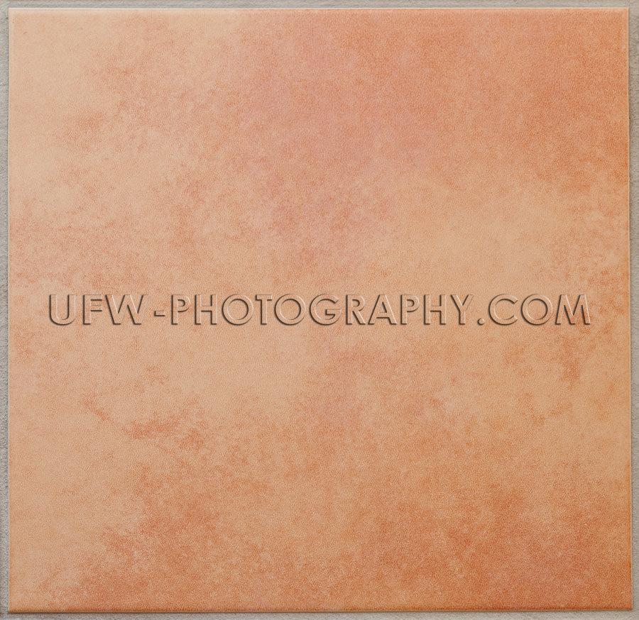 Einzelne aprikosenfarbene Keramikfliese Textur Vollformat Stock