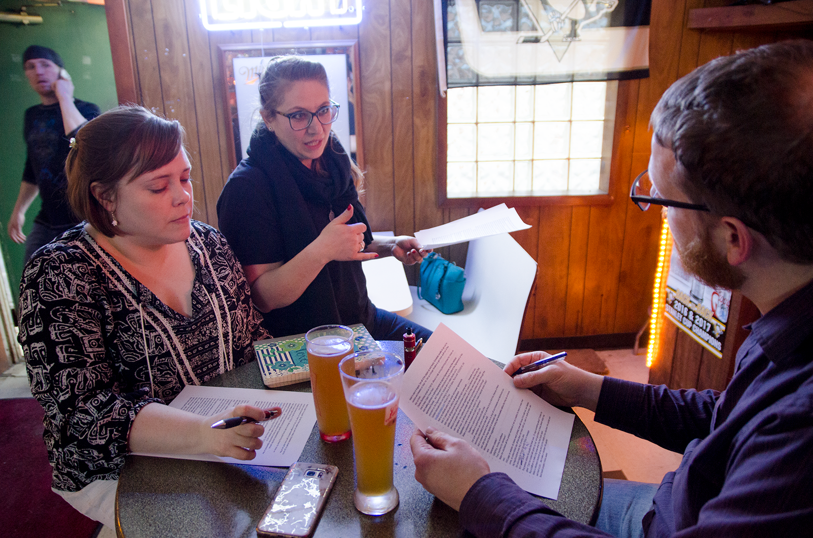 Kristina debriefing with two core volunteers after the 2018 Cabin Fever Festival.