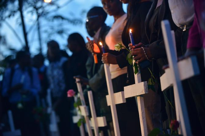 People hold candles alongside wooden crosses at Freedom-Corner in Uhuru Park in Nairobi, Kenya, April 7, 2015, during a vigil for the victims of an attack claimed by Somalia's al-Qaida-linked al-Shabab insurgents at Garissa University College, in which 148 people were killed.      TONY KARUMBA/AFP/GETTY IMAGES