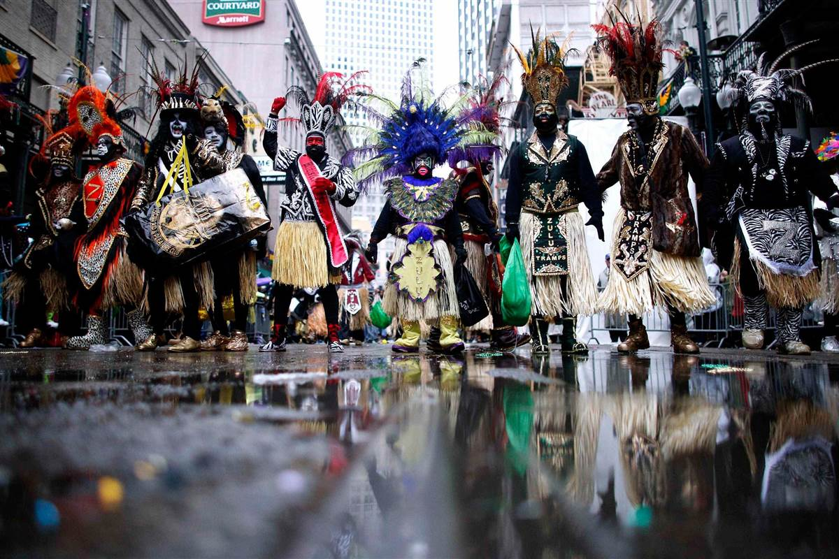 Members of the Krewe of Zulu parade down St. Charles Avenue on a cold, wet, Mardi Gras Day in New Orleans. JONATHAN BACHMAN / Reuters, courtesy of NBC News