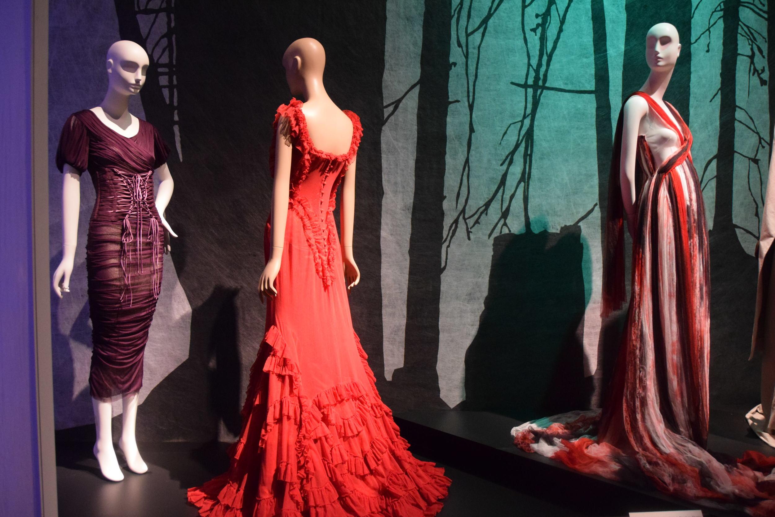Purple dress, Dolce & Gabbana (2014); Red dress, Soronen (2007), Striped dress, Rodarte (2008)