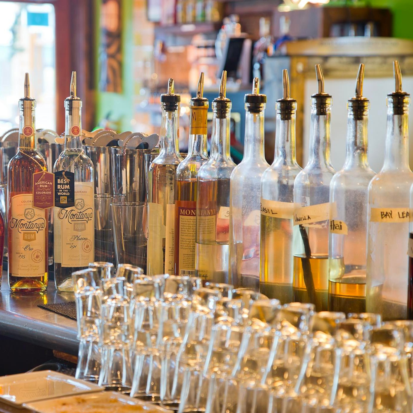 Homemade syrups line the bar at Montanya Distillers