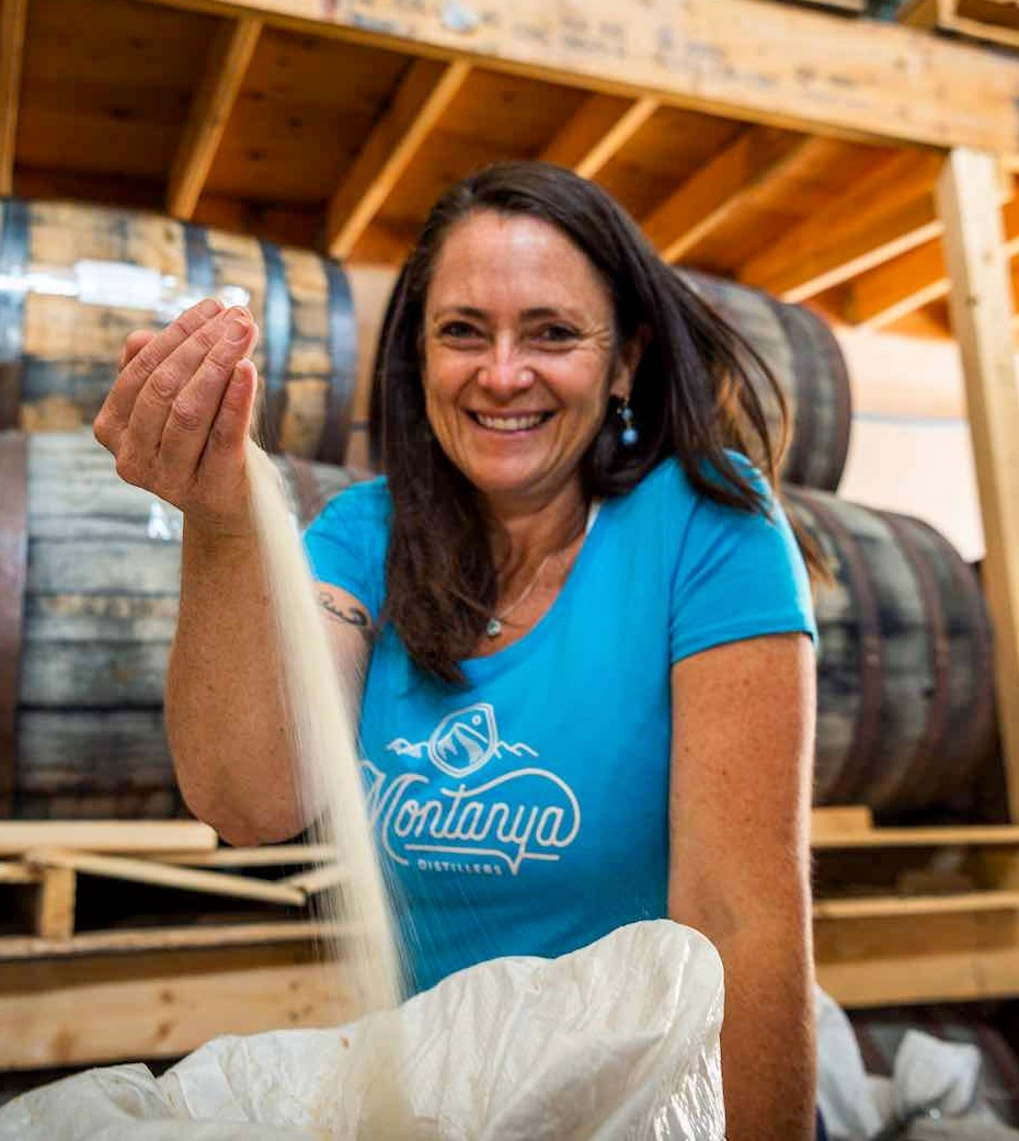 Founder and owner Karen Hoskin with the raw cane sugar that goes into Montanya rum.