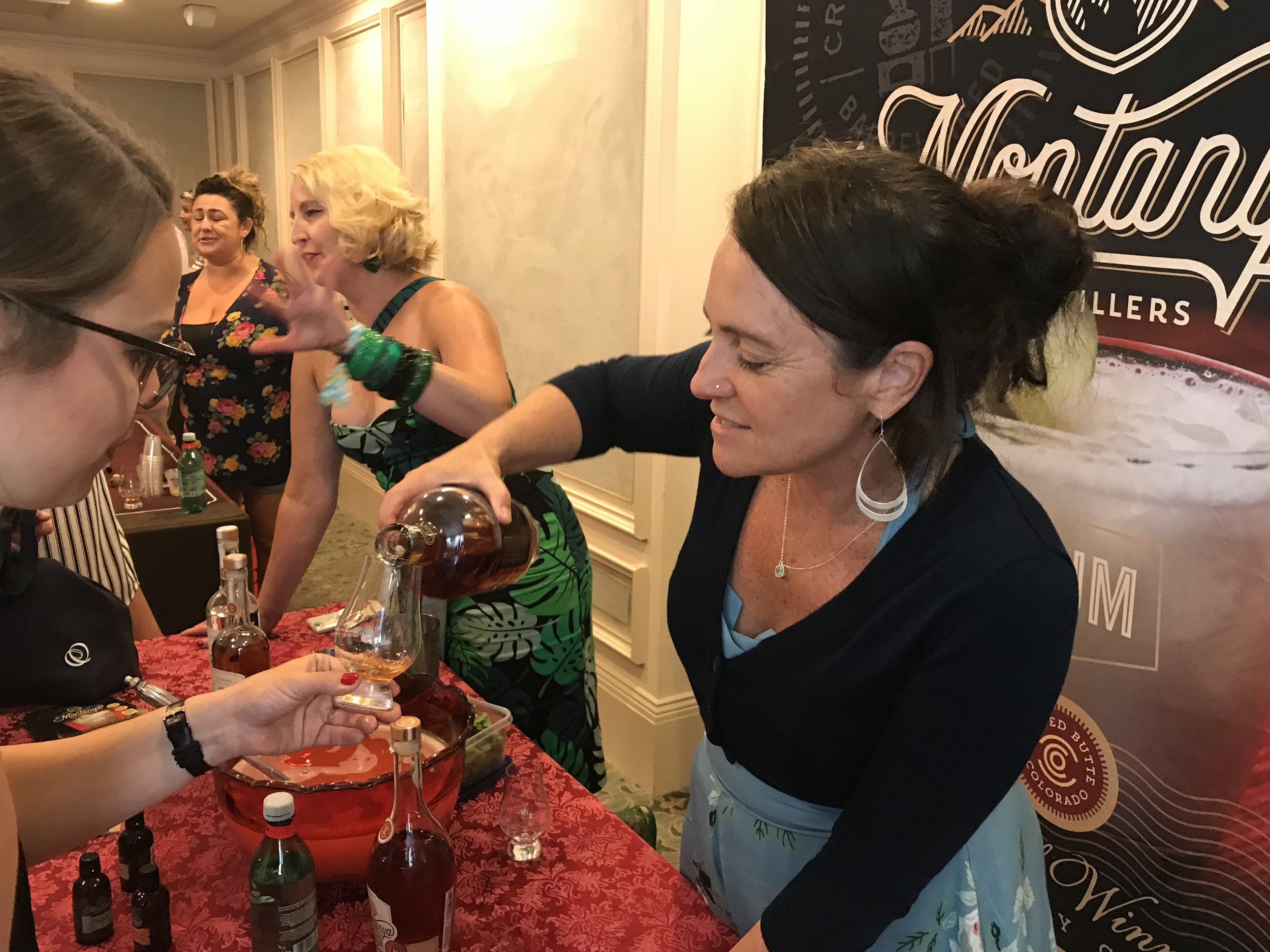 Karen and Michelle serving tastes at Tales of the Cocktail 2018.
