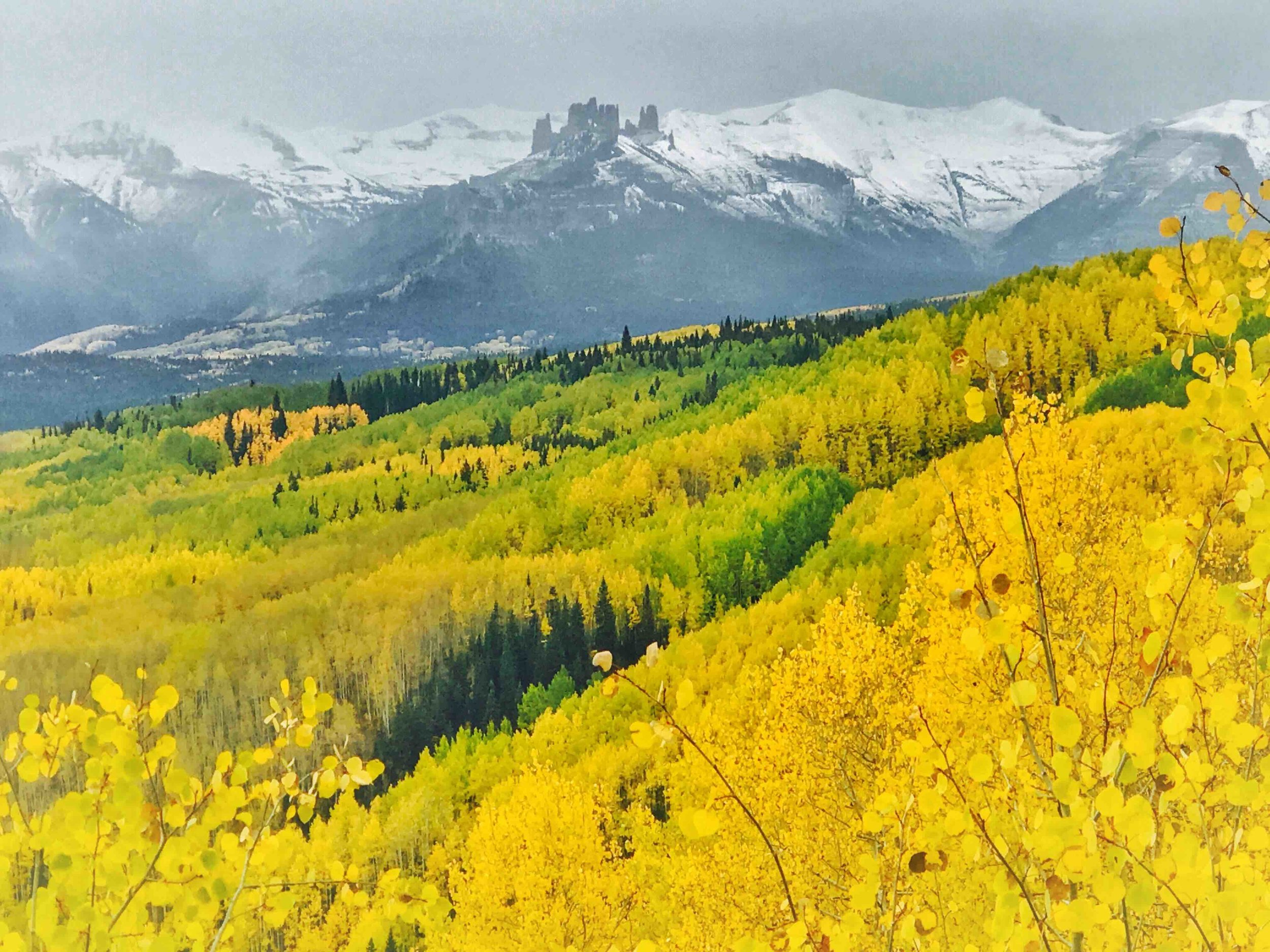 An autumn view of the Castles, near Crested Butte, Colo. and Montanya Distillers.