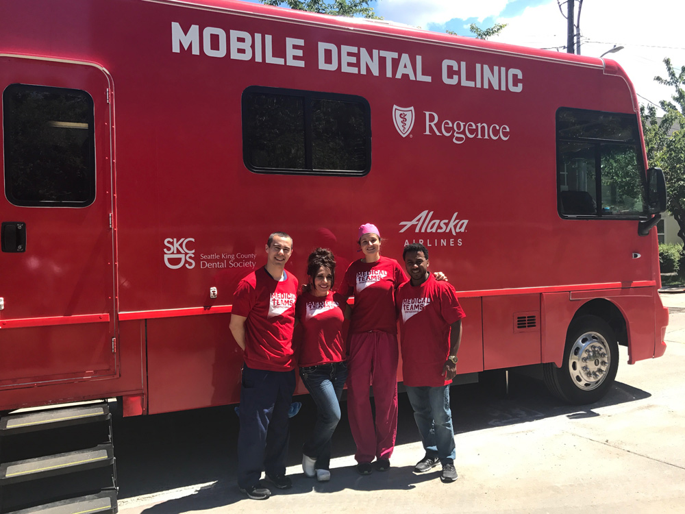 Dr. Suzuki and other volunteers outside a local mobile dental clinic treating the underserved in Seattle / King County.