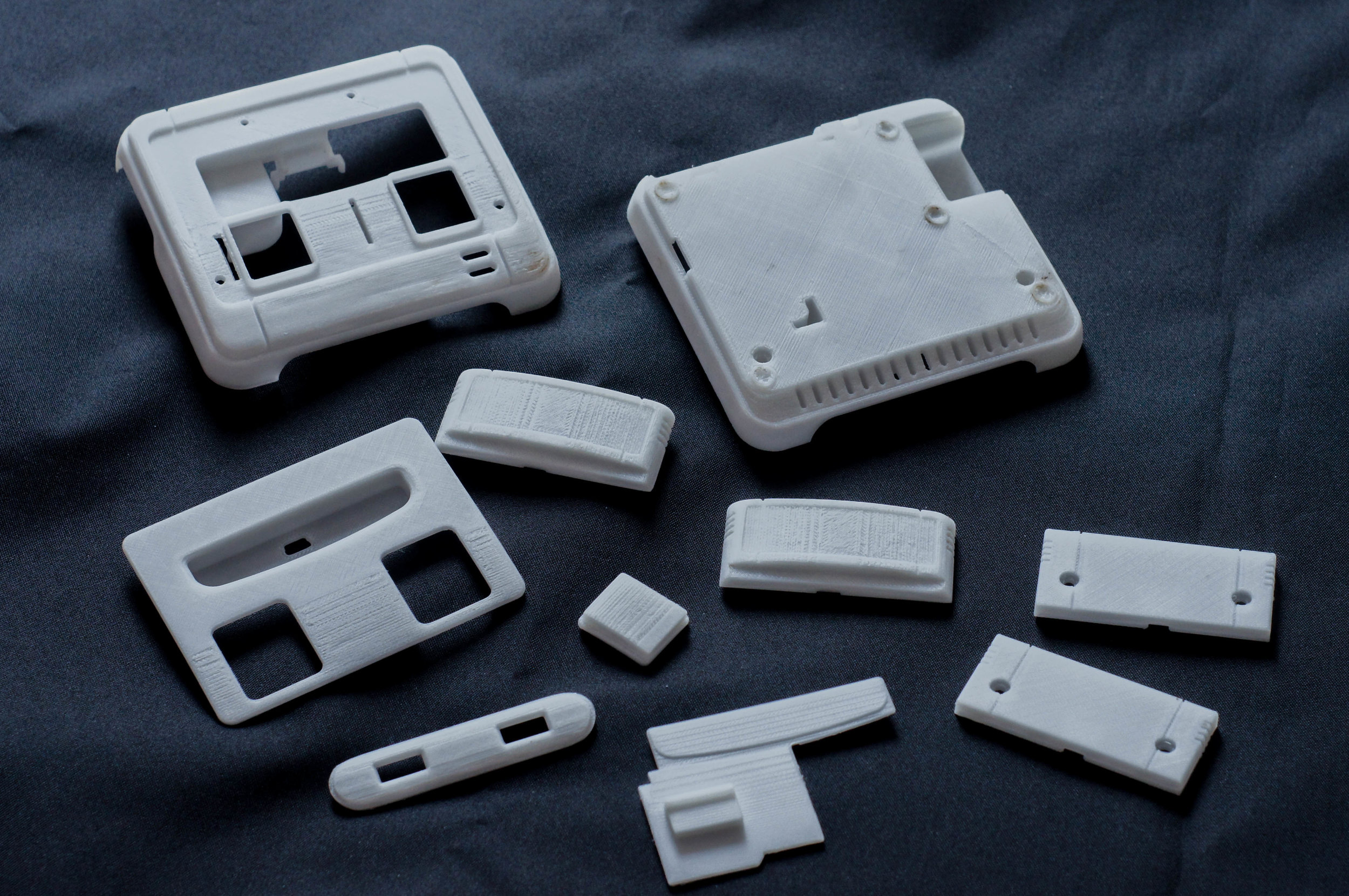 Parts were designed and modeled in CAD and FDM 3D printed. The parts required sanding due to the layer thickness of the 3D print.