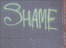 shame spraypainted on a wall