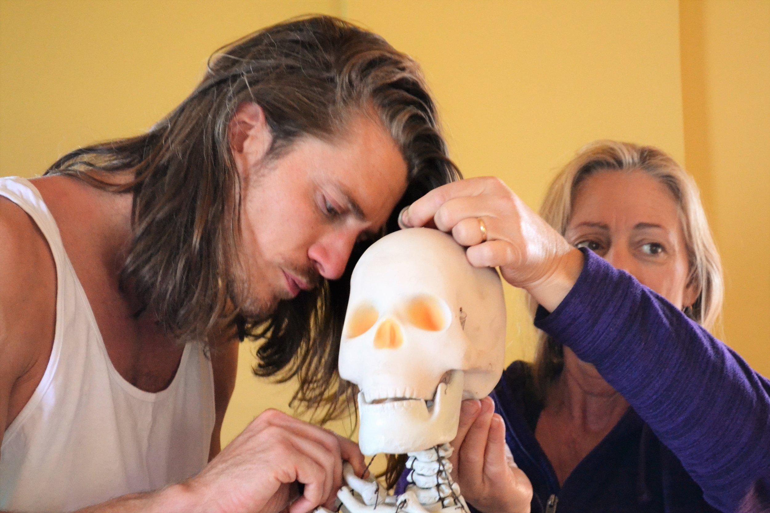 Bonding with the anatomy skeleton, yoga teacher training in Nepal.JPG
