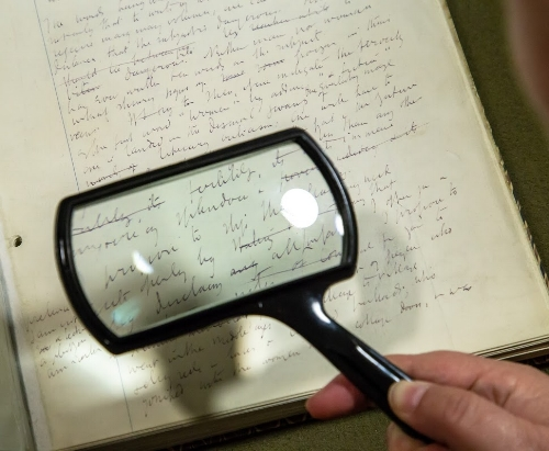 VW handwriting with magnifying glass.jpg