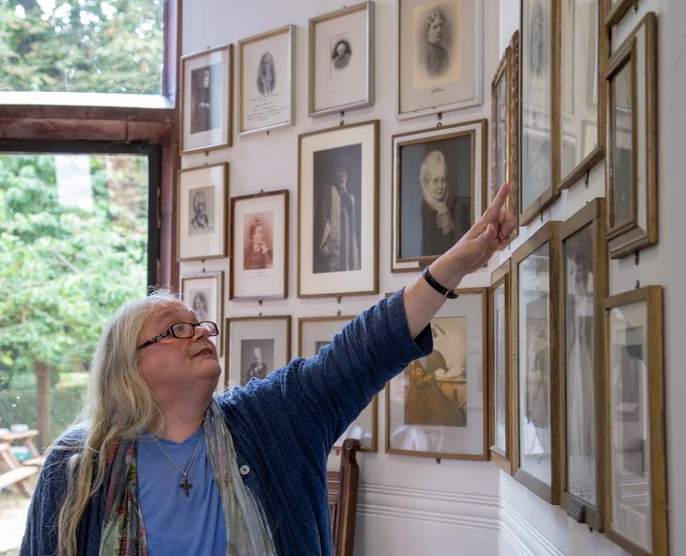 Alison points to portraits girton.jpg