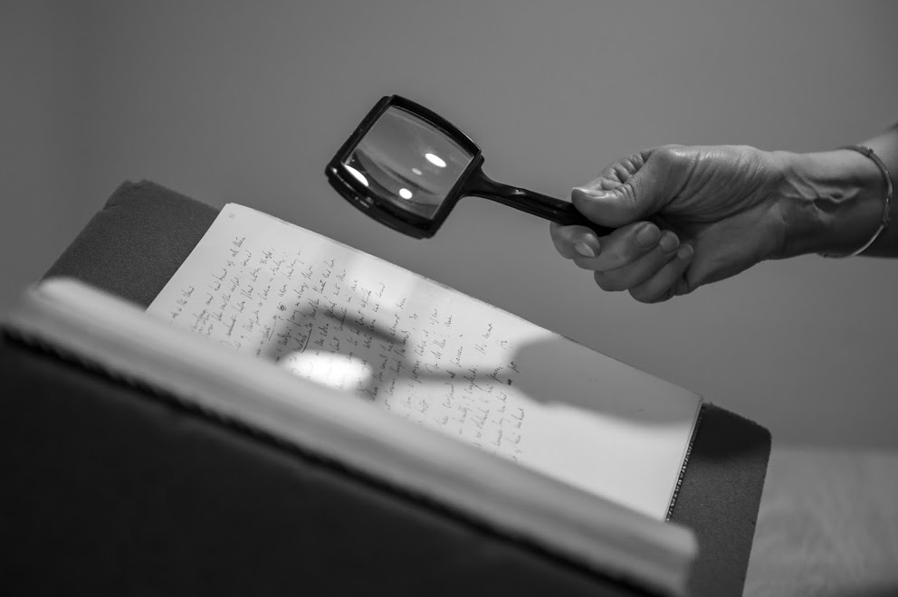 hand and magnifying glass B+W*.jpg