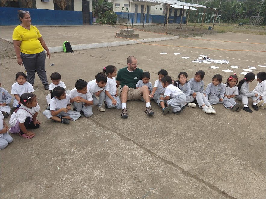 Volunteer Jeremy Williams with some school children in Clementinas, Ecuador.