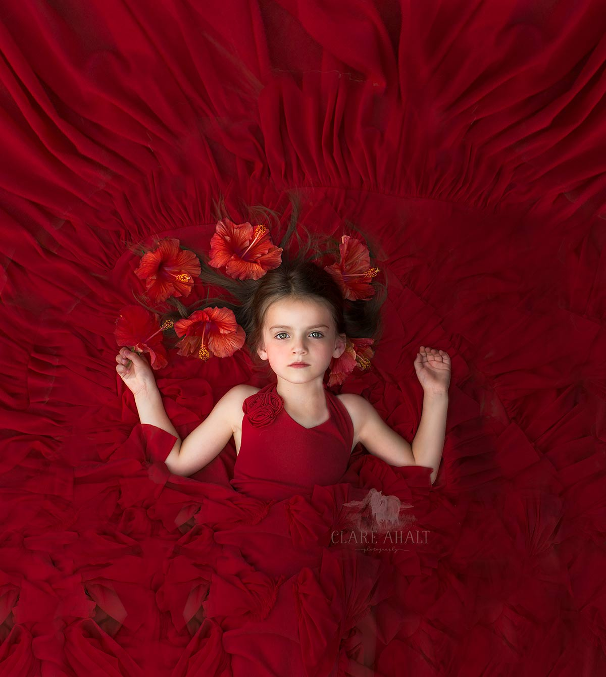 Portrait of a Child in a red dress, photographed in Maryland by Clare Ahalt Photography