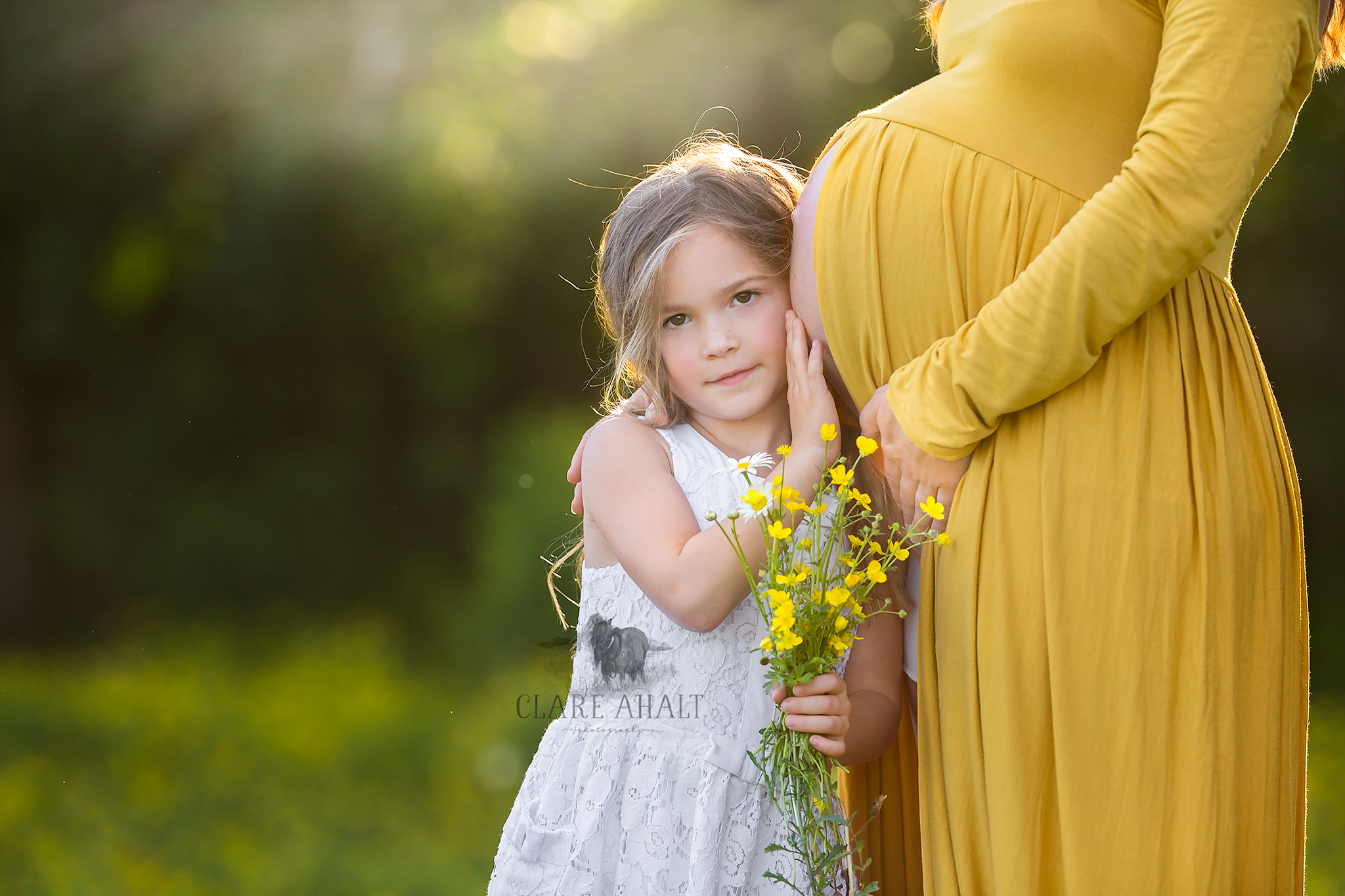 Maternity photograph of a mother and her child taken by Clare Ahalt Photography, a fine art portrait photographer located in Frederick MD serving Maryland, Northern Virginia and Washington DC