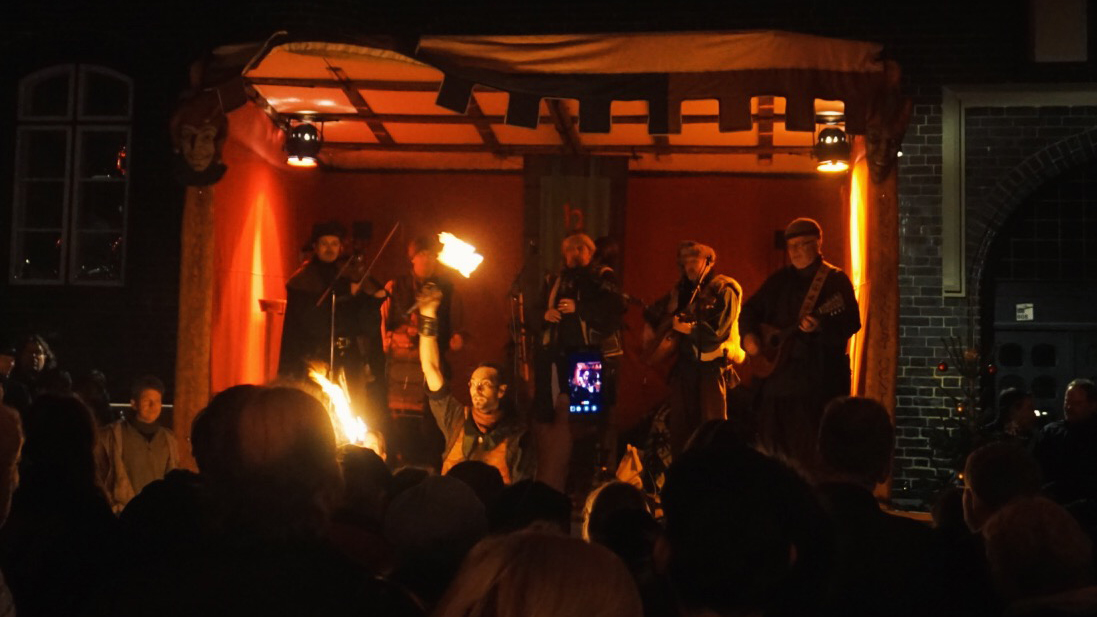 Fire dancers and musicians playing medieval music