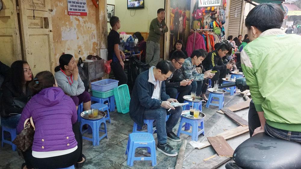 Eating on the sidewalks -Hanoi