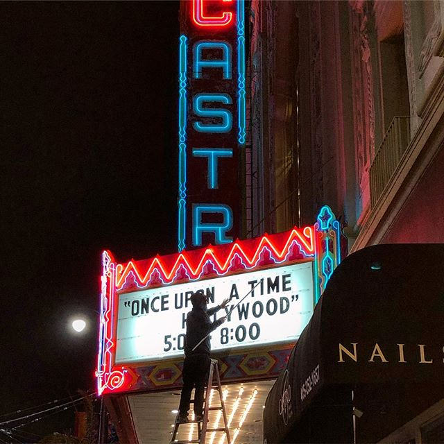 I don't think I've ever see someone actually change the letters on an old-fashioned theater sign. So cool!