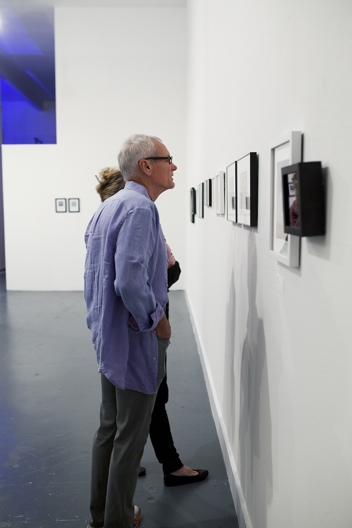 The best part of small artwork is that it is more intimate and draws the viewer in. Here, two patrons getting a closer look at my lumen prints. Photo Credit: © Lisa Kimberly