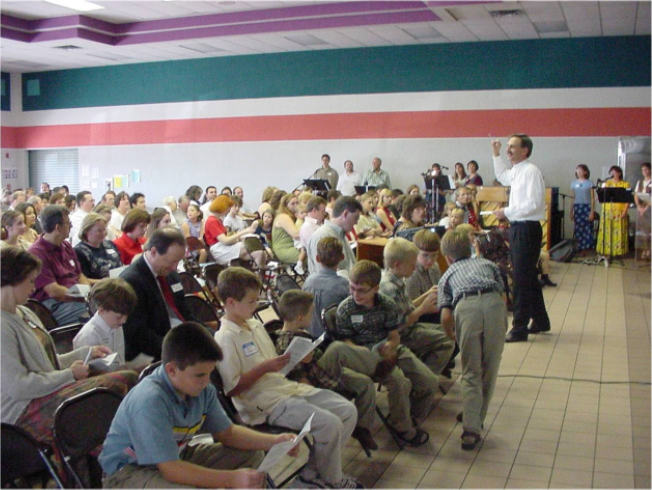 Sunday morning worship moved to Brookhollow Elementary in Pflugerville as attendance grew.