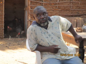Mr.Juma in front of his poultry house