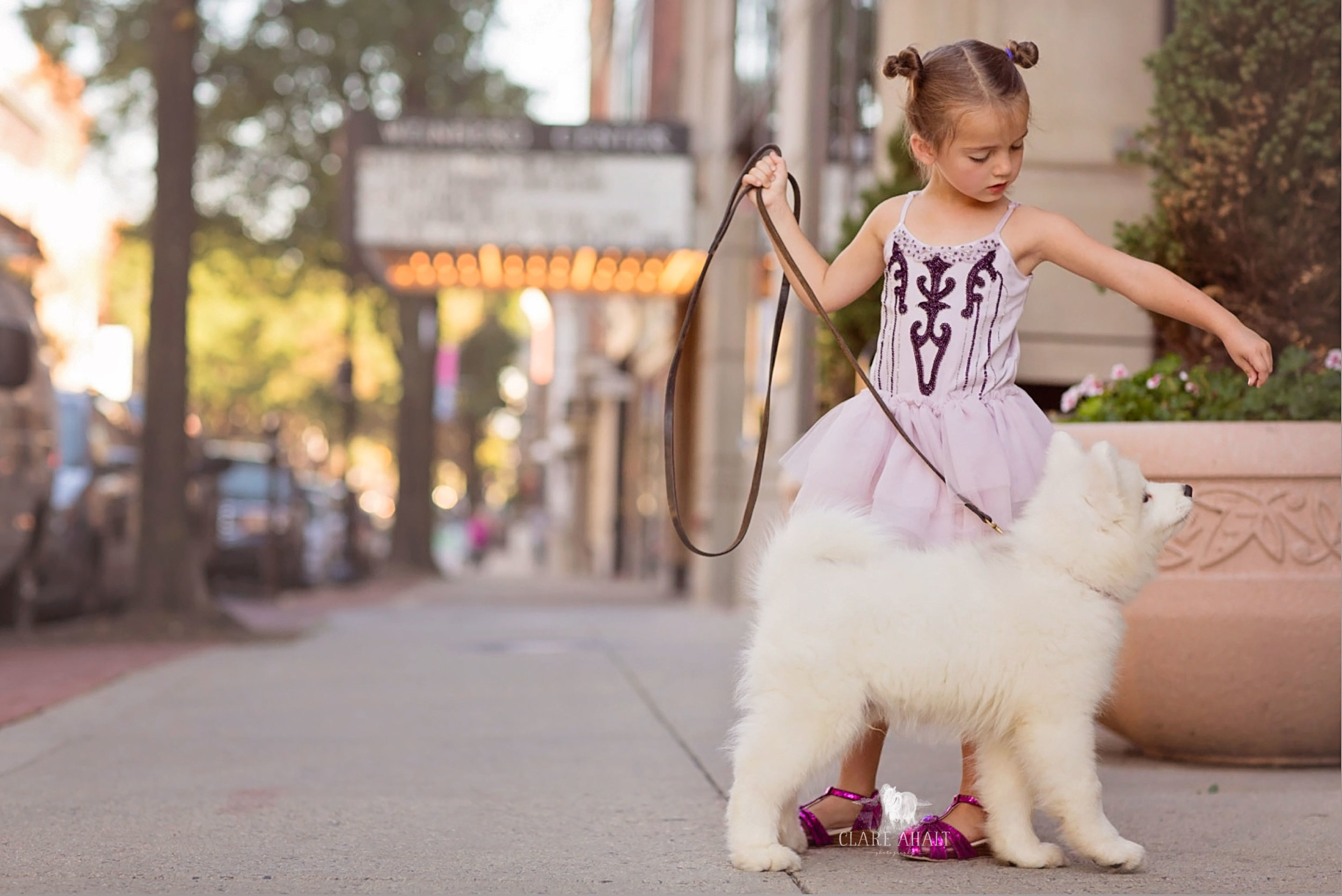 Jefferson Veterinary Hospital owner and veterinarian Dr. Ahalt's daughter and puppy in downtown Frederick MD, near the Weinberg Center