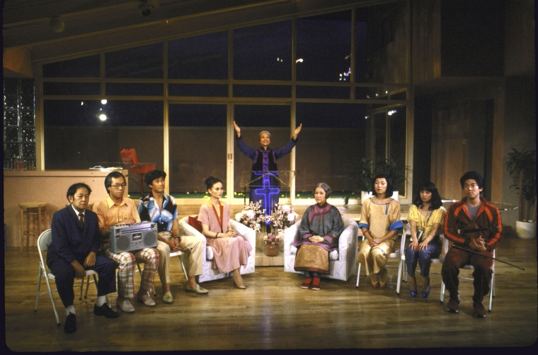 Actors (L-R) Victor Wong, Jim Ishida, Michael Paul Chan, Helen Funai, Tina Chen, June Kim, Jodi Long, Lauren Tom and Marc Hayashi in a scene from the New York Shakespeare Festival's production of  Family Devotions . Photo by Martha Swope, Courtesy NYPL.
