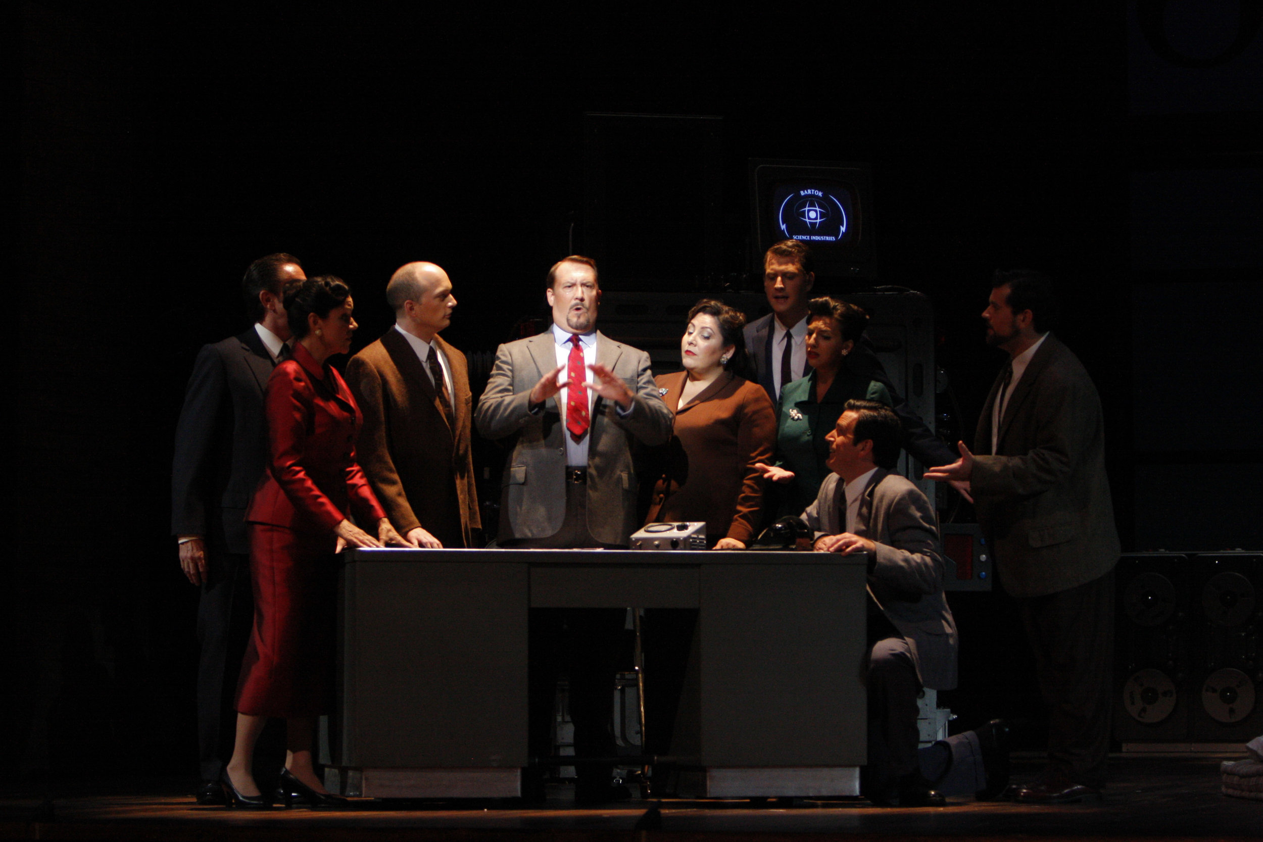 Gary Lehman (center) as Stathis Borans in The Fly. Photo by Robert Millard for the Los Angeles Opera, 2008