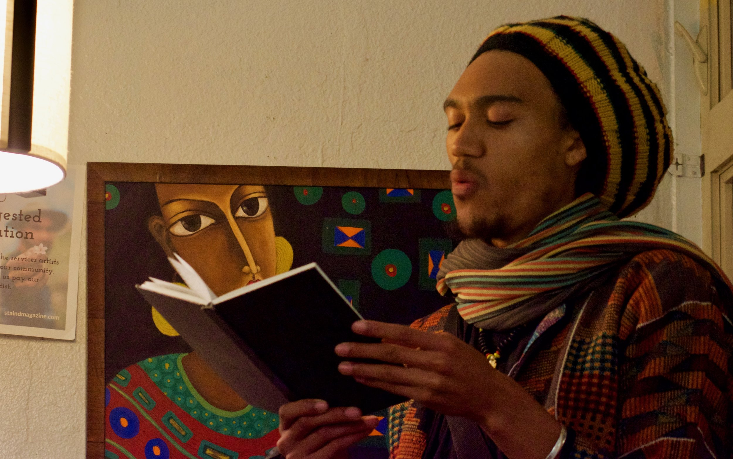 Akilkuumba reads at Stain'd Arts open mic at Whittier Cafe