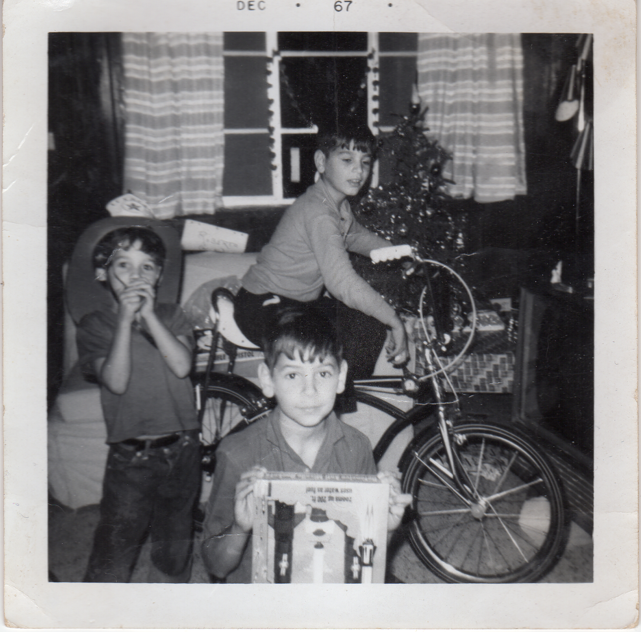 While we came to the US in 1965, it wasn't until 1967 that we could even be in a place to celebrate Christmas. This photo is taken in the home I grew up in. Me (in center bottom) with two of my brothers. Eddy on the left and Robert on the bike.
