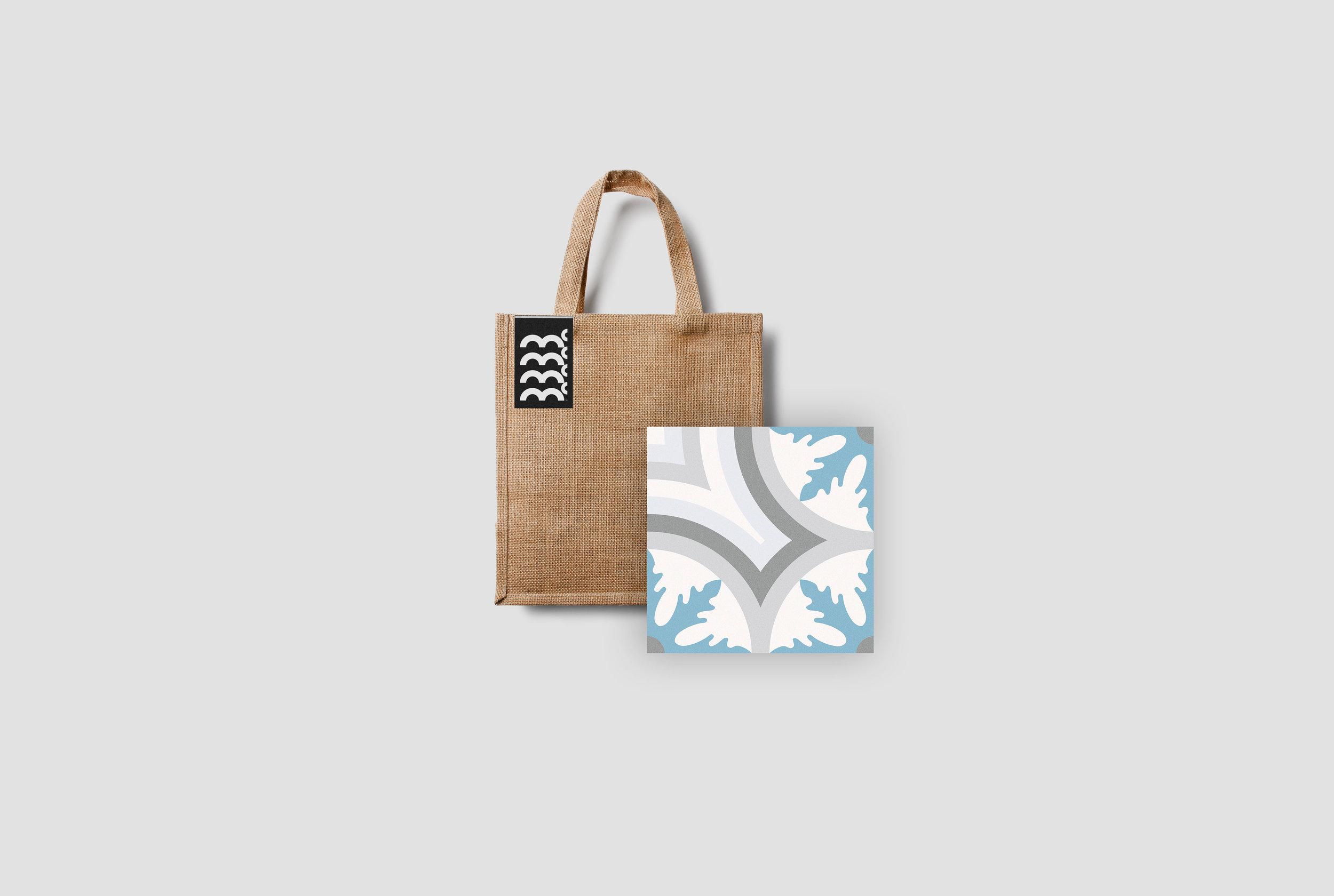 """Burlap TILE bag with """"Mc"""" label."""