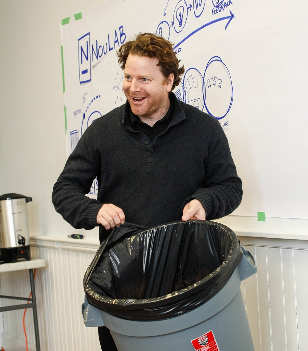 Paul Messer, Associate with Percolab, leads a prototyping exercise using waste management as an example.