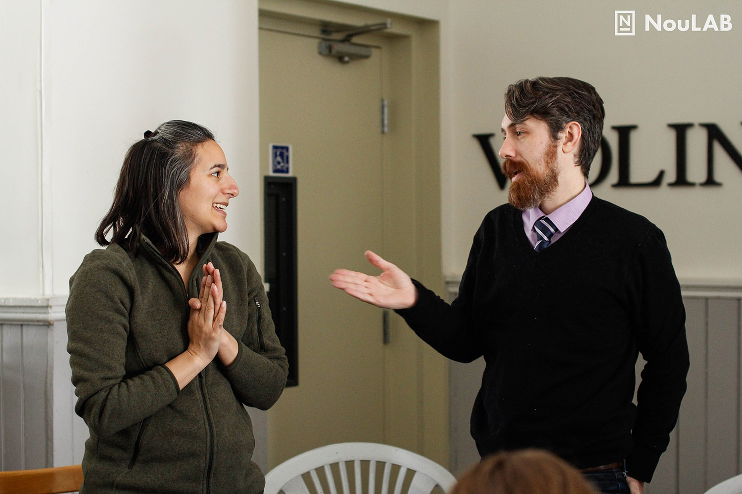 Bethany Deshpande and Nic Clement role play a prototype for resolving a conflict of interest.