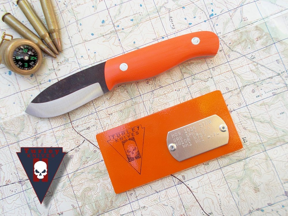 M9 Goblin with a half height grind, orange g10 scales and stainless loveless bolts