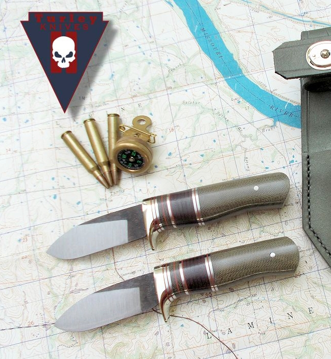 M9 Goblin hidden tangs with near full height grind, nickel silver half guard, red- stainless steel-o.d. green and leather spacers, o.d. canvas micarta handles.