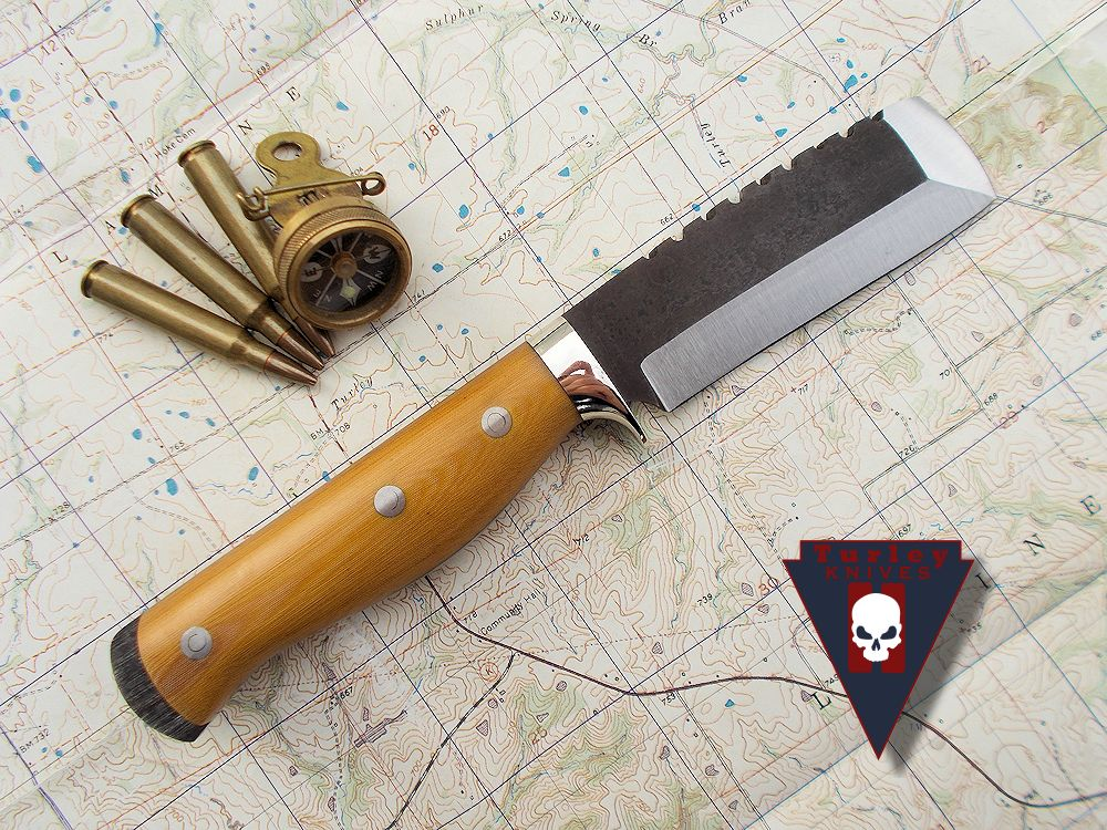 M10 with standard grind, saw teeth, nickel silver half guard, natural linen micarta scales and stainless loveless bolts.