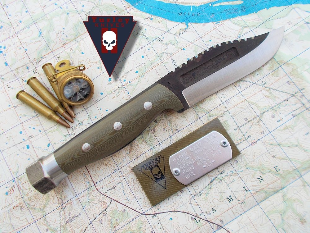 """Full tang M14 with a Dogface blade, half height grind, fullers, saw teeth, o.d. camo g10 scales, 1/8"""" black spacers, 1018 steel bolt pommel, stainless loveless bolts"""